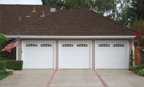 $370 for Garage Door Spring and Rollers Replacement